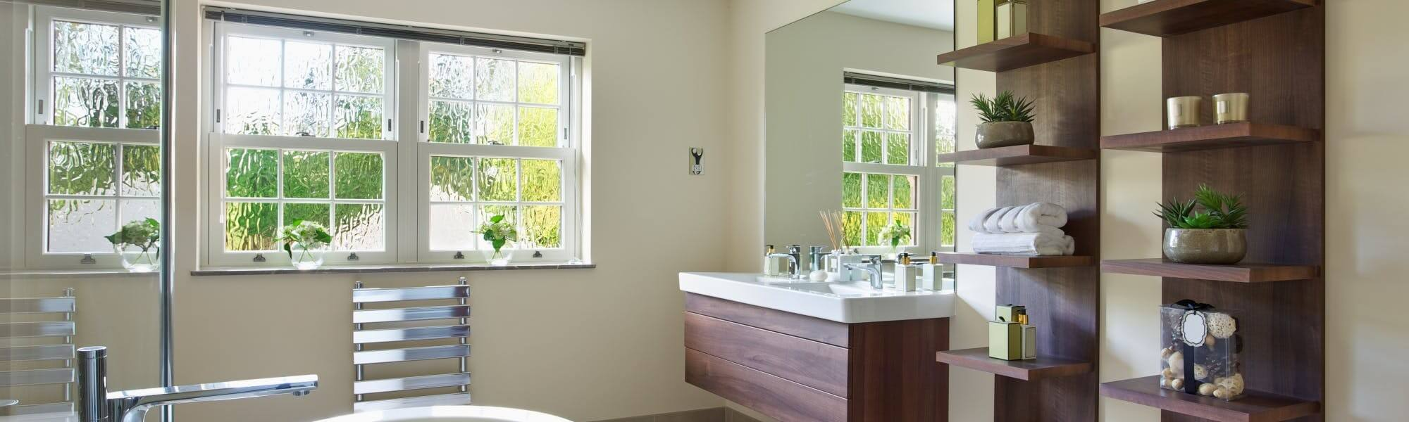Large bathroom with installed wall radiator and bathroom sink base units furniture