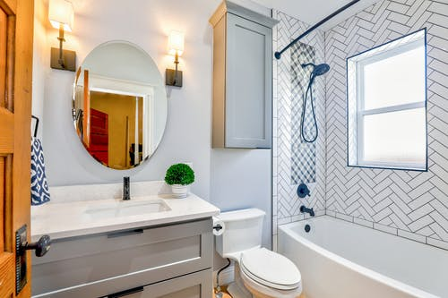 Bathroom installation with bath, sink and toilet installed