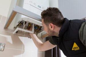 Gas Safe Engineer installing new boiler