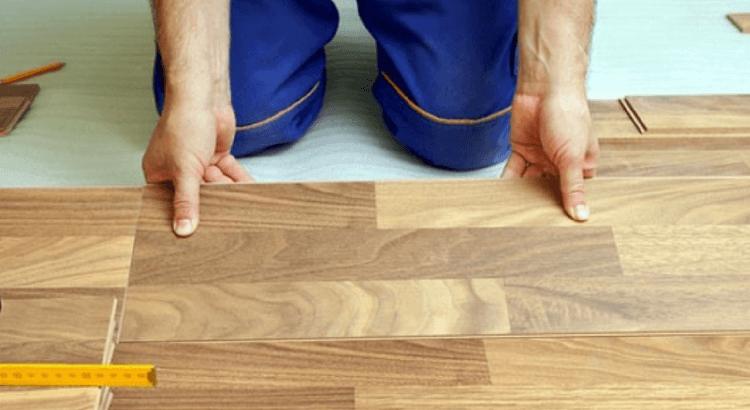 tradesman fitting wood flooring